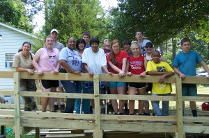 Home Works Volunteers pose on the ramp they built for a Client.