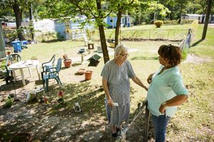 Ann Pennington, Client, speaking with her Joann Bellamy, her volunteer and friend.