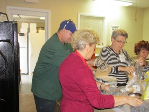 Steve Beal from Bateman and volunteers help unpack the fresh hot meals.