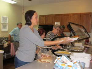 Volunteers serving hot meals to our congregate participants.