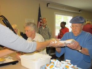 Congregate meal participants being served their meals.