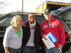 Volunteers delivering bags: Peggy Jacobs, Eva Massey with Bob White, Volunteer Coordinator from St. Michael the Archangel Knights of Columbus Council 15250.