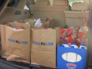 Eva Massey's car is packed to the brim with holiday meals about to be delivered!