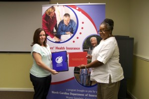 SHIIP Volunteers Lisa Hughes & Ellouise Garvin hold up Lisa's new certificate!
